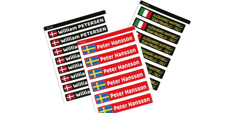 Personal sticker sheets with different names and flags on colored backgrounds.